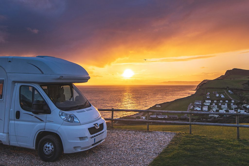 The unmatched view over the Jurassic Coast from the gravel touring pitches at Highlands End Holiday Park