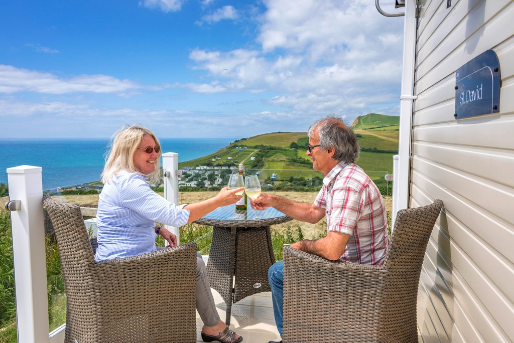 Holiday Home Owners enjoying the view from their caravan decking
