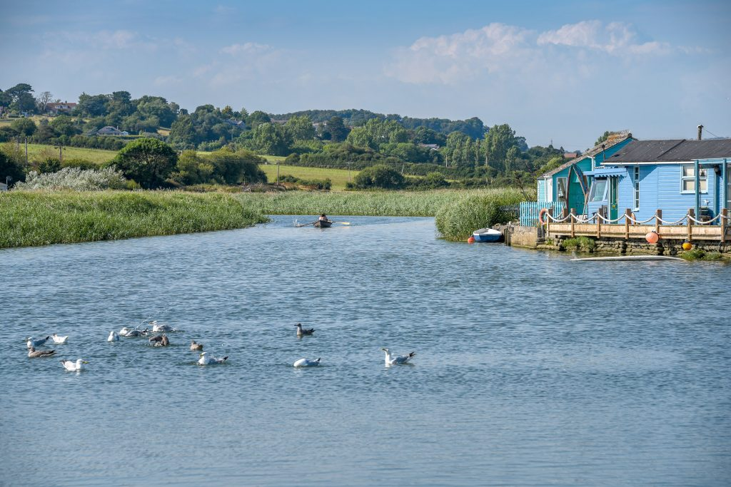 stand up paddle boarding along the river brit west bay