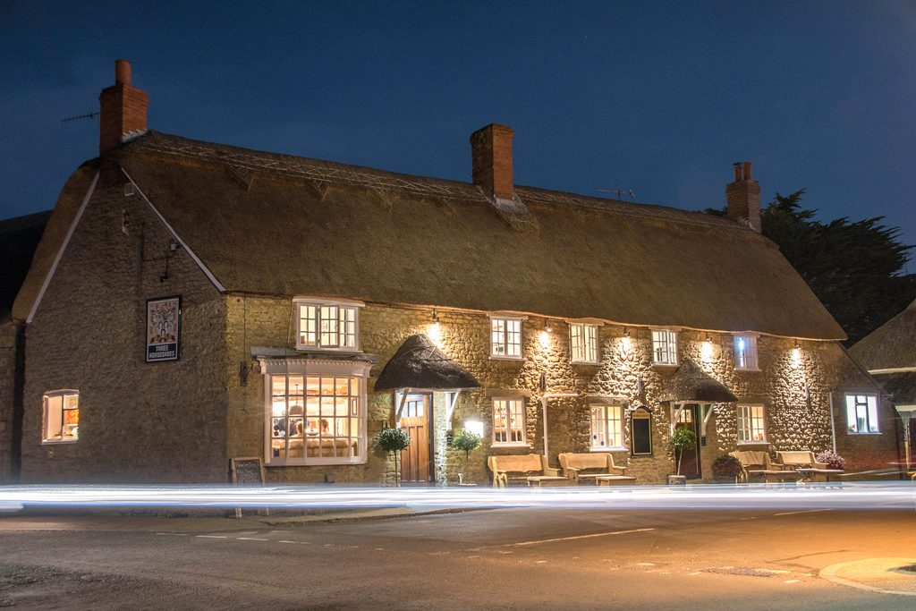 the three horseshoes pub in burton bradstock